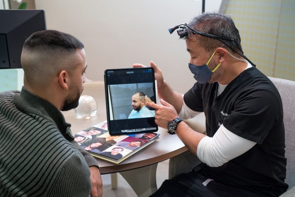 Jae Pak Showing Patient Before Pictures of Himself